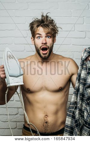 Naked Screaming Man With Iron