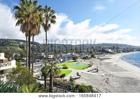 LAGUNA BEACH CALIFORNIA - JANUARY 6 2017: Main Beach from the bluffs. Volleyball courts basketball courts and grass expanse line the popular coastline.
