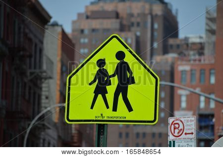 school crossing sign - pedestrian crossing signal - yellow square warning sign with black silhouettes