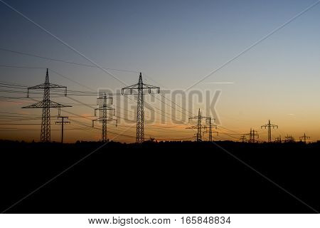 Electric power lines steel tower in landscape sunset sunrise dawn silhouette 3