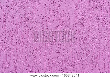 Fragment of a painted pink wall with plaster