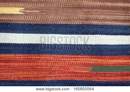 Woven fabric with color horizontal stripes as texture background closeup
