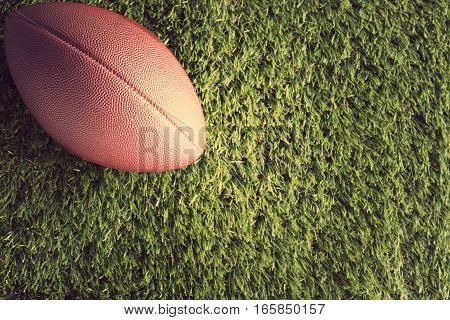 Vintage football over grass seen from above