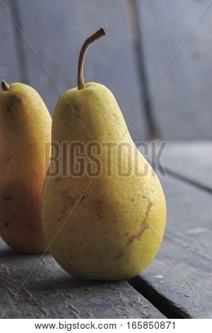 Fall pears on rustic background, thanksgiving dinner