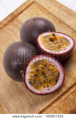 photo of passion fruit on a wooden background