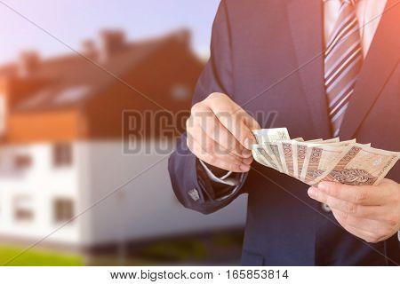 Polish Businessman Holds Money. The Loan On The House