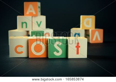 Cost Word With Colorful Blocks