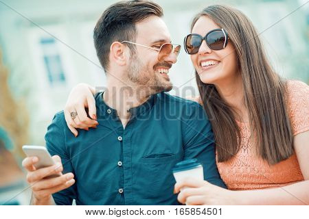 Happy young couple in the cityhaving fun.