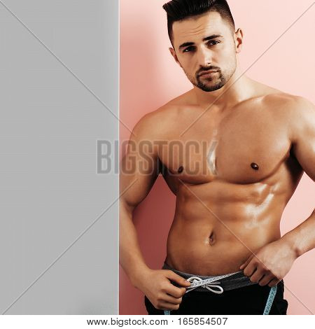 Muscular Man With Tape Measure