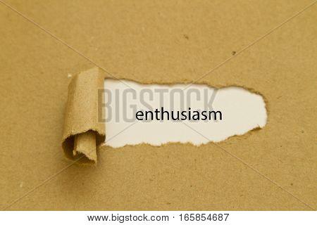 Enthusiasm word written under torn paper .