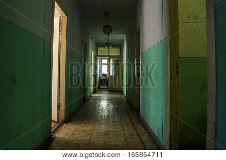 the grunge hallway of abandoned building of hostel