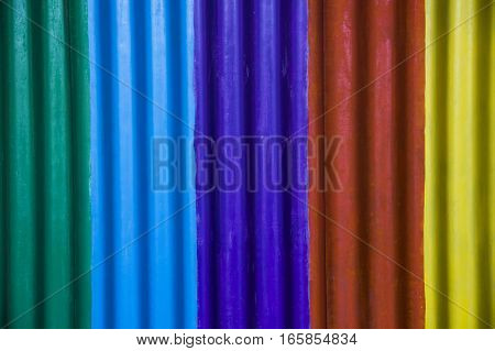 Close-up of slate wall painted at rainbow colours