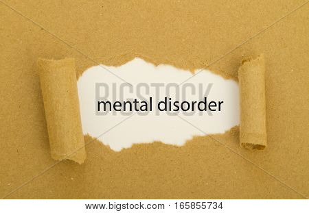 mental disorder written under torn paper .