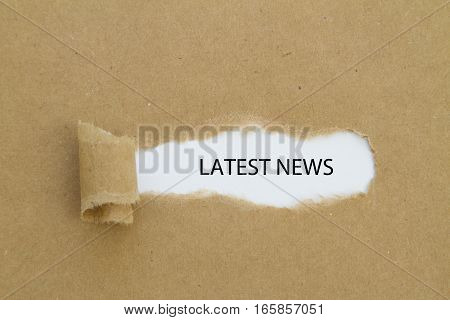 LATEST NEWS word written under torn paper.