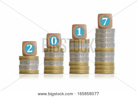 2017 Year money or financial growth concept with pile of coins and wooden cubes