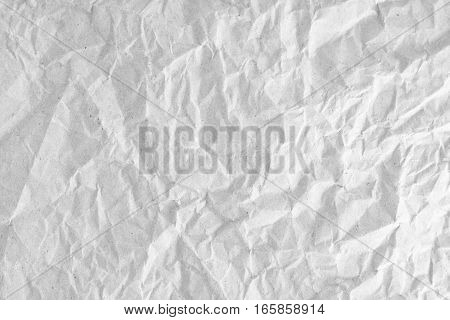 White crumpled or wrinkled paper background or texture