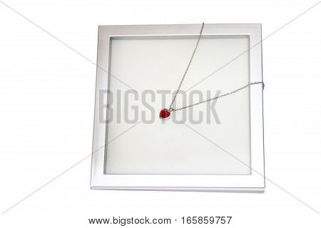 Studio shot of red jewelry heart isolated over white background.