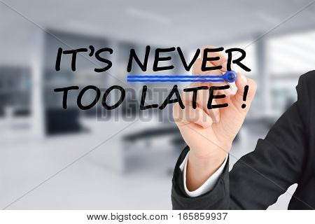 It is never too late text with businesswoman hand writing on transparent background