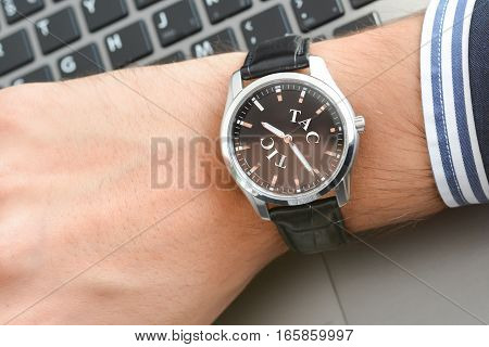 Businessman looking at his watch being too late