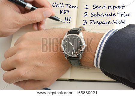 Businessman hand looking at his watch suggesting being out of time