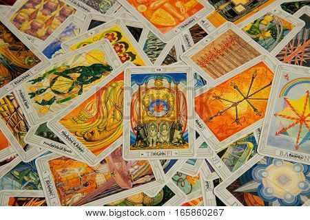 Moscow, Russia - December 4, 2016: Tarot card The Chariot with other cards. Thoth tarot deck. Esoteric background