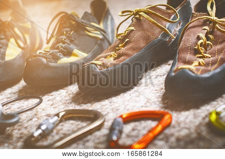 Climbing and mountaineering equipment on a carpet. Shoes, carbine, rope, lope, ascend-er. Concept of outdoor and extreme sport