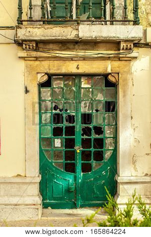 Green door to abandoned building in downtown Lisbon, Portugal july 2015