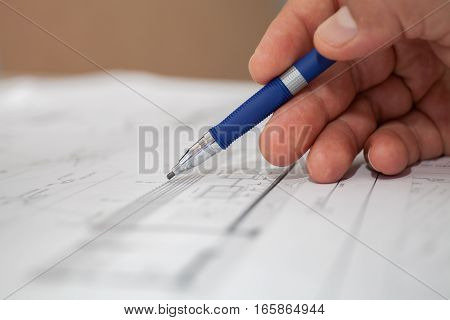 construction engineer draws pencil selective focus stock photo