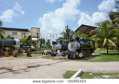 REMEDIOS CUBA - JULY 27 2016: Buildings and trains at the Museum of Sugar Industry and Museum of Steam at Remedios is an old Cuban sugar mill with its own railway.