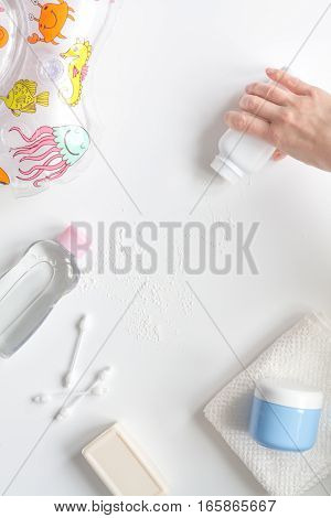 baby accessories for bath with duck on white background top view