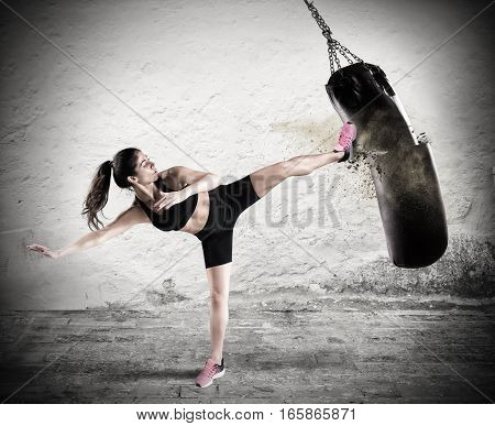 Woman is training with the punching bag. Fitboxe woman coach