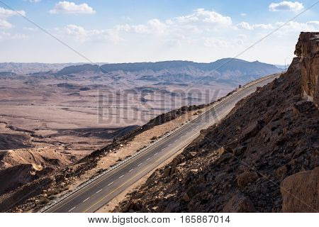 Landscape with highway road through the desert and mountains in Israel. Travel road trip.
