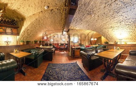 MOSCOW - AUGUST 2014: Panorama of the interior of a luxury restaurant in the historic cellar with brick vault