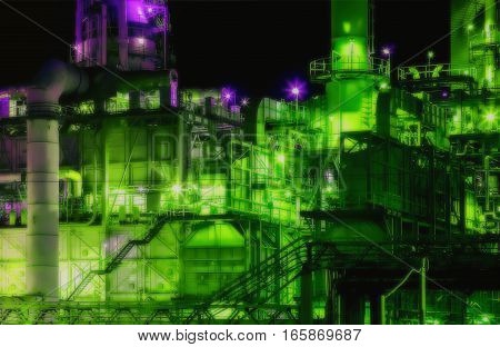 Scenic of oil refinery plant shines at night in green and purple tones. Lens Blur filter.