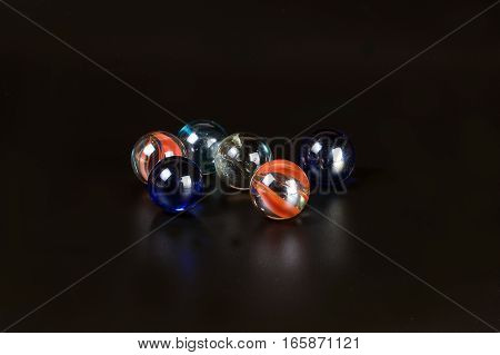 Glass marble ball on black background spear toy