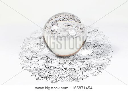Glass Crystal Ball Reflection over design art refraction on white background