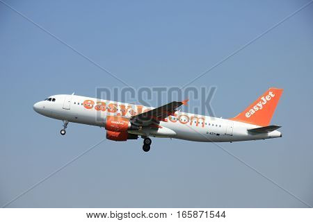Amsterdam The Netherlands - June 12 2015: G-EZTI easyJet Airbus A320-214 takes off at Amsterdam Airport Schiphol Polderbaan runway. EasyJet is a British low-cost airline carrier based at London Luton Airport