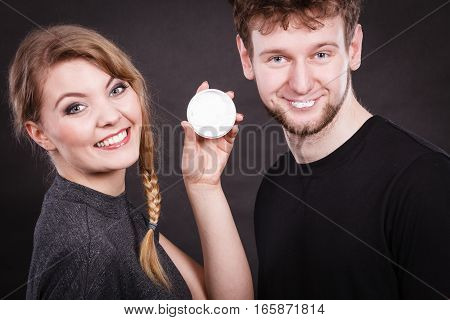 Fun and joy. Healthcare and protection. Funny smiling couple playing with moisturizer cream. Lovely woman with charming man.