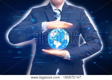 Technologies connecting the word with business man holding digital planet in hands on circuit background Advanced technology concept
