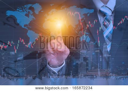 Financial trading stock concept with businessman using technology to check worldwide market stock data over cityscape night view