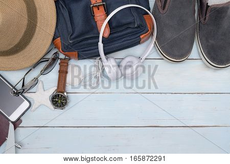 Top view of traveler accessories with copy space Essential vacation items Travel concept background