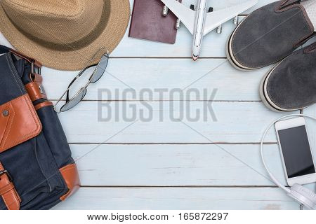Overhead view of traveler accessories on vintage wooden table with copy space Essential vacation items Travel concept background