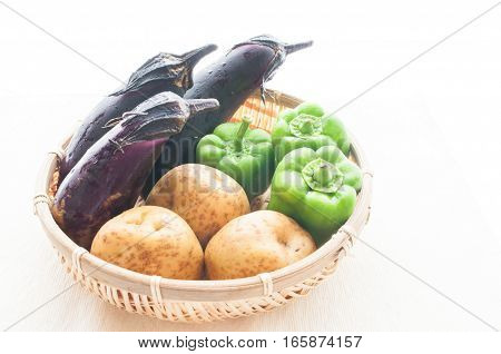 Vegetables in the basket. Eggplant, potatoes, onion