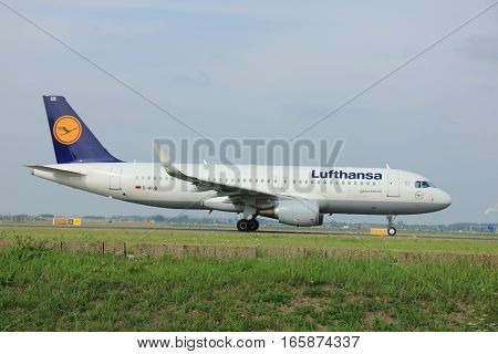 Amsterdam The Netherlands - August 10 2015: D-AIUB Lufthansa Airbus A320-200 taxing on the Polderbaan runway to the main terminal of Amsterdam Schiphol Airport