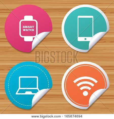 Round stickers or website banners. Notebook and smartphone icons. Smart watch symbol. Wi-fi sign. Wireless Network symbol. Mobile devices. Circle badges with bended corner. Vector