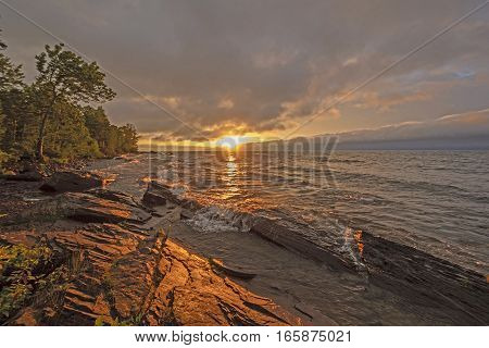 Dramatic Sunset on a Wild Lake Shore on Lake Superior in Porcupine Mountains State Park in Michigan