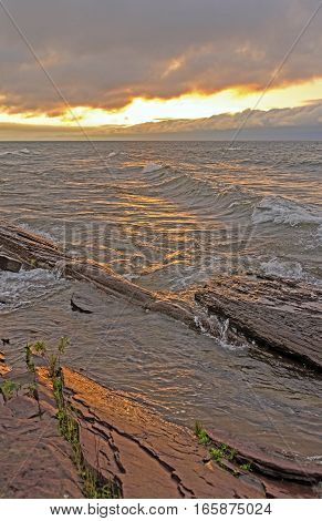 Sun Clouds Waves and Water on Lake Superior in Porcupine Mountains State Park in Michigan