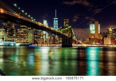 Brooklyn Bridge Over East River At Night In New York City Manhattan