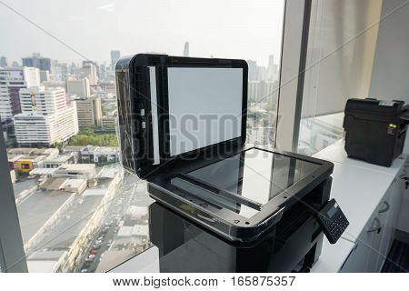 open the printer plate for scanning documents