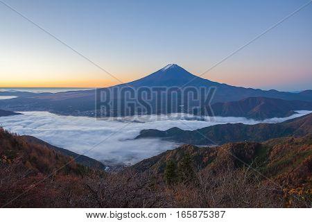 Mountain Fuji and sea of mist above Kawaguchiko lake in morning autumn season